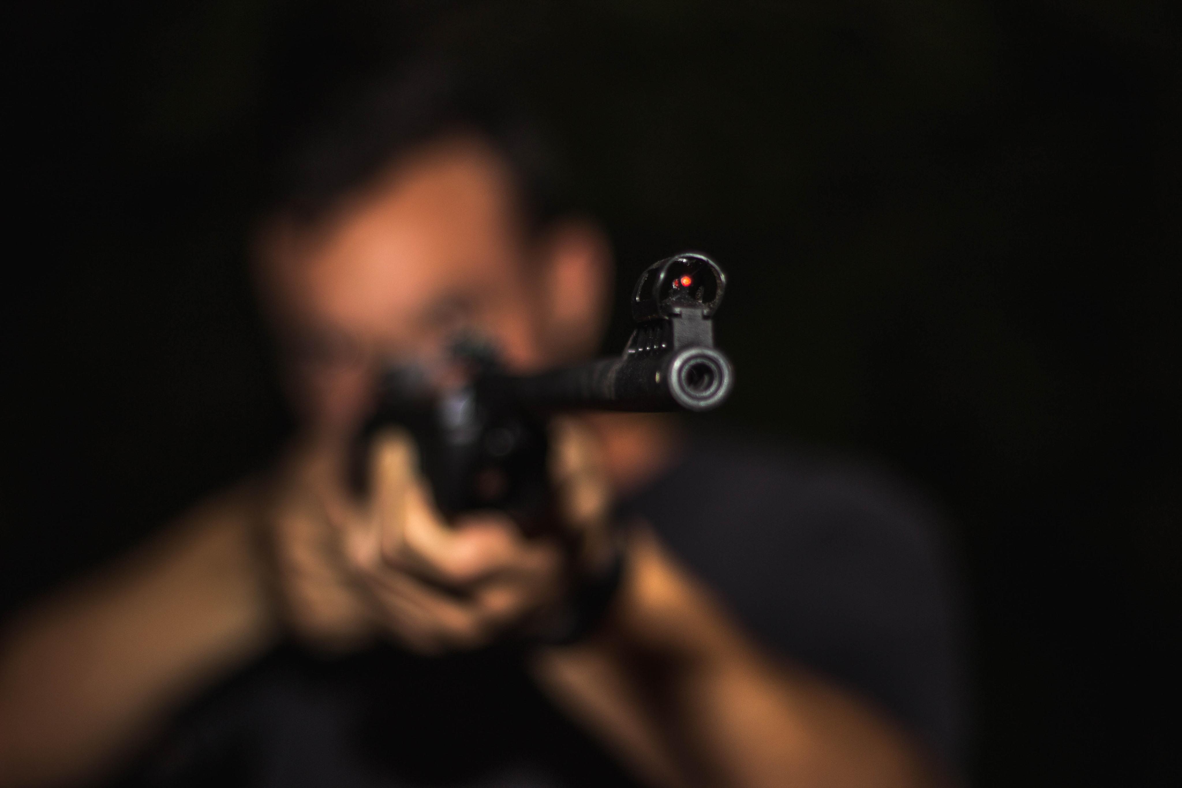 Man holding air gun